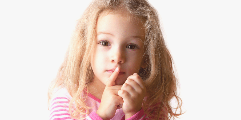 image of a small child holding her fingers over her lips seen and not heard